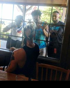 Enzo Amore looking out the window and see Kofi Kingston, Xavier Wood & Big E
