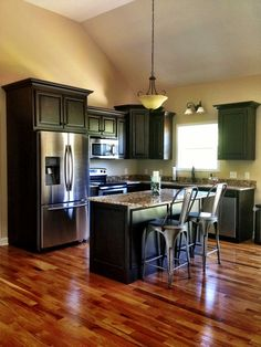 black kitchen cabinets with dark wood floors - Google Search