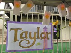 Rapunzel birthday sign and paper bag lanterns