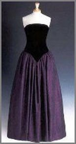 Designed by Catherine Walker, this black silk-velvet bodice with a dark burgundy and black silk-satin skirt. The original design of the dress had a high neck and long sleeves, but Diana had it altered to make it strapless. Diana first wore this gown with it's original design to a charity function in London in 1987. The gown was part of the Christie's auction and raised $ 24,150 for Diana's charities.