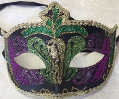 This sparkle design purple,gold and green venetian style masquerade mask is new. This mask is paper mache with ribbon tie concept to create a comfortable fit and great to reuse if needed.  This mask is 10 inches across and 5.5 inches high Masquerade Masks #reflections_vintage_toronto #masks #masquerade #masqueradeball