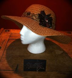 Check out this item in my Etsy shop https://www.etsy.com/listing/103080006/wide-brim-sunhats-brown-with-beads