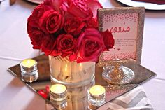 purple flowers, large mason jar with table number on it, with little candle holders around the bottom