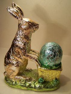 Chalk ware colored foil Easter Bunny Rabbit pushing Cart Egg Basket on wheels