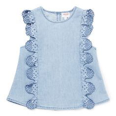 100% Cotton. Sleeveless chambray top features front placement broderie frills. Regular fitting silhouette. Available in Powder Blue.