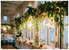 Wedded Wonderland // Bridal Table Dressing // Luna Park Wedding // A hanging enchanted garden // Suspended blooms in white ivory and fresh greens // Accented with trailing of soft green vines and garlands of white orchids // Flowers included roses, hydrangea, orchids, amaranths and seasonal blooms // Hanging lights // Chandelier // Bronze Table Dressing // Modern Wedding Inspiration