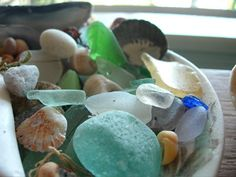 The souvenirs of Christmas Cove beach...Mermaid's tears, smooth, luminous sea glass, that shines through the seaweed and stones.