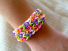 Rainbow Loom Bracelet Patterns | Rainbow Loom friendship bracelet rubber bands in purple, pink, orange ...