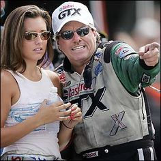 Ashley Force Hood and her father legendary NHRA race driver John Force