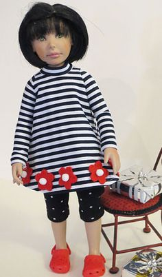 Leeann is wearing a jersy dress, trimmed with felt flowers. The dress has mock turtle neck and long sleeves with a center back opening. She is also wearing a pair of jersey leggings to keep her warm.    This will also fit Effner's storybook doll,and Cutom House Petite Ai.