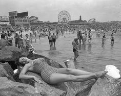 theniftyfifties: On the beach at Coney Island, 1954