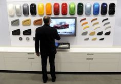 One of Tesla store in the world. They are displaying tablet that can design people's own car with variety of choice of color. It can make clients to satisfy the needs that people want to buy unique cars that no one has in the world.