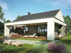 Taras można częściowo zadaszyć konstrukcją nawiązującą do bryły domu. Ciekawym pomysłem jest ułożenie obok tarasu płyt kamiennych na trawniku. Projekt: Blanka II. Fot. Dobre Domy