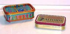 Altoid tin covered in polymer clay