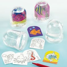 Sealife Colour-in Snow Globes Children can create their own underwater world by colouring the pre-printed designs and inserting into this glittery snowstorm. Each snow globe comes with 2 assorted designs and white glitter. Water to be added. Crafts For Kids, Arts And Crafts, Diy Crafts, Christmas Stocking Fillers, Body Adornment, Party Bag Fillers, Underwater World, White Glitter, New Theme
