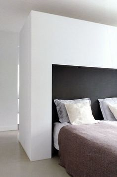 Clean lines. Bedroom inside a renovated 1930's villa by Dutch interior designer Remy Meijers.