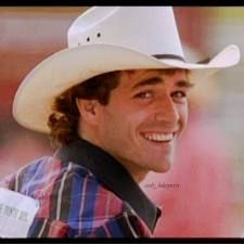 luke perry as lane frost... I do believe this was the first cowboy every country girl fell in love with after watching this movie