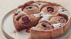 """We like to think of this dessert as the turducken of pies -- spiced, cranberry-stuffed apples are baked in a pie shell, surrounded by cake batter. It's inspired by the bird's-nest pudding in Laura Ingalls Wilder's classic """"Farmer Boy."""""""