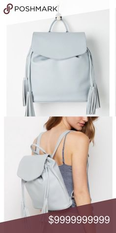 """Coming soon.like to be notified Chic faux leather tassel pull string backpack, magnetic snap closure, interior zip compartment, woven lining. Base approx 4 x 12"""" height approx 12.5"""" new from non smoking home Bags Backpacks"""