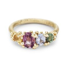 Ruth Tomlinson alternative engagement ring of coloured sapphires in yellow gold, handmade in London