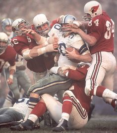 Dallas running back Dan Reeves is gang-tackled by Joe Robb (No. 84), Chuck Walker (No. 79) and Don Brumm (No. 86) during a 1966 game between the Cowboys and Cardinals (Neil Leifer/SI) #EasyPin