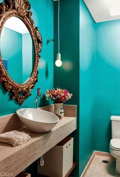 I chose this bathroom because I love the way the colour palette harmonizes well together with the coolness of the teal and the warmness of the beige vanity and flooring giving a very elegant but relaxed feeling.