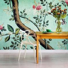 printed wallpaper + white masters chair by kartell.