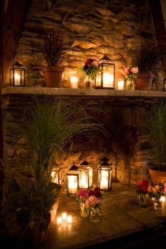 Lanterns on a stone fireplace.