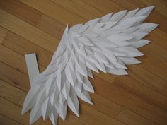 Paper angel wings...handmade... love this and totally doable as well since it uses smaller pieces of paper instead of large ones. Can be attached to sturdy cardstock or cardboard in the middle.
