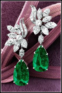 Alternate view: Harry Winston emerald and diamond earrings with 14 carats of diamonds and two emeralds weighing 16.57 and 14.58 carats. Just spectacular~
