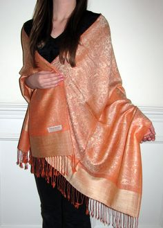 Orange shawls and wraps are a must have for fall. Wear seasonal pashminas, orange pashmina shawls and look beautiful.