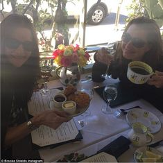 Brooke Shields quaffs champagne and nibbles on scones and jam ahead of detox retreat.