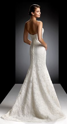 Backless is beautiful and the House of Oleg Cassini does it beautifully