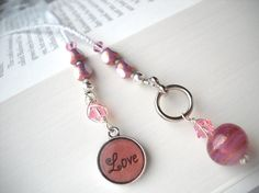 """All My Boyfriends Are Fictional"": pink and white 'Love' beaded bookmark by BuniqueBeads. $15."