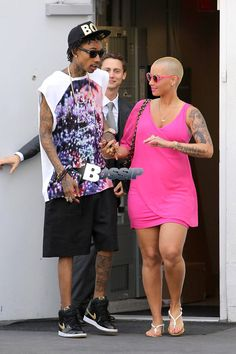 New parents, Wiz Khalifa and Amber Rose leave their little baby, Sebastian behind to enjoy some shopping time together in Beverly Hills.  As the couple walked back to the car, Wiz was a gentleman and opened the door for his lady.