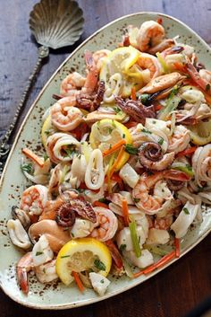 Healthy Seafood Salad - Seafood cooked in white wine, lemon juice, garlic and peppercorns, then tossed with vegetables and parsley.