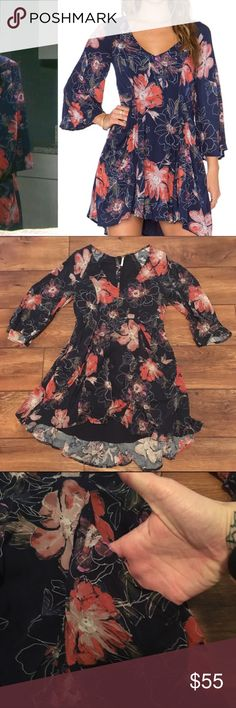 Free People dress NWOT Free People floral dress with pockets, side zipper, and buttons on the back. 32 3/4 inches long 29 3/4 inches long at the shortest part Free People Dresses Mini