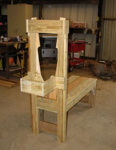 Goat milking stand shows 6 views of design