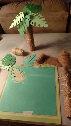 Palm trees made from paper towel rolls. Using burlap, twine and Beach cricut cartridge.