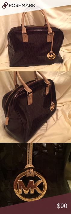 Michael Kors Patent Signature Bowling Bag Michael Kors Signature Patent Bowling Bag. Used a few times, in great condition. No pen marks or scuffing anywhere except on the handle (pictured) beautiful bag big enough to fit anything and everything. Grab before it's gone! Michael Kors Bags Totes