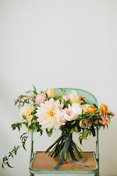 Event and floral designer Juli Vaughn used dinner-plate dahlias, garden roses, and parrot tulips in soft shades of pink and peach to create this lush, loosely structured bridal bouquet.   Photo by Betsi Ewing