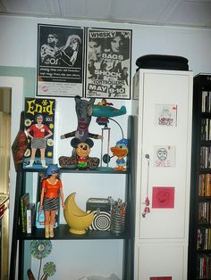 Desk with collectibles ( Enid Coleslaw / Ghost World / Daniel Clowes / Disney / Donald Duck / Mickey Mouse / Punk Posters / The Bags ) by GennieGoose's Page, via Flickr