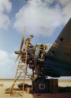 Royal Air Force ground crew overhauling a Bristol Beaufighter's Hercules engines at Magrun.
