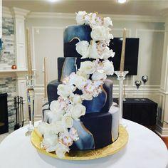 Calumet Bakery Marbled fondant wedding cake with gold.