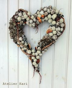 A heart shaped wreath made with lichen and birch and other materials from the Norwegian forrest. By Kari Rudi