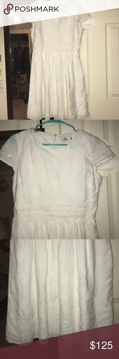 Vineyard Vines Dress White vineyard vines dress with beautiful detail. Never worn, selling because I don't want to see it waste away in my closet and I need to save up for college! I would post a picture with it on however it does not fit me well. Can ship out next day, feel free to make an offer! Vineyard Vines Dresses