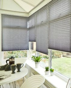 No doubt about it, the monochrome style is popular. To get the look in your conservatory mix charcoal Pleated blinds and white furniture and accessories.