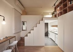 Look at the small kitchen living are and mezzanine level of the tiny apartment 217x155 Going Vertical: Tiny 22 Sqm Apartment Maximizes Space in Style