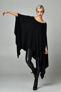 A popular poncho without sleeves in leopard print that has beautiful drape that is perfect for every and any body type. Wear is straight necked or off the shoulder. Wear it with sexy leggings or with denim cut offs.  Popular and always in demand. Made in USA.  www.cherishusa.com www.fashiongo.net/cherish