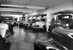 Stack & Co. garage full of cars and trucks. Max Dupain photo, c 1950.